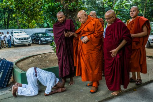 A Sri Lankan Buddhist bowing in front of Sitagu Sayadaw, in Delgoda, Sri Lanka.