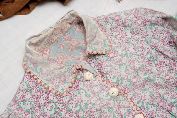 The fading pattern on a dress shows that it was worn with an apron.