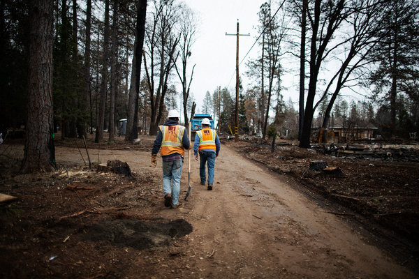 Pacific Gas & Electric workers in Paradise, Calif., in January. The town was destroyed by the Camp Fire, which state officials found was caused by PG&E's power lines.