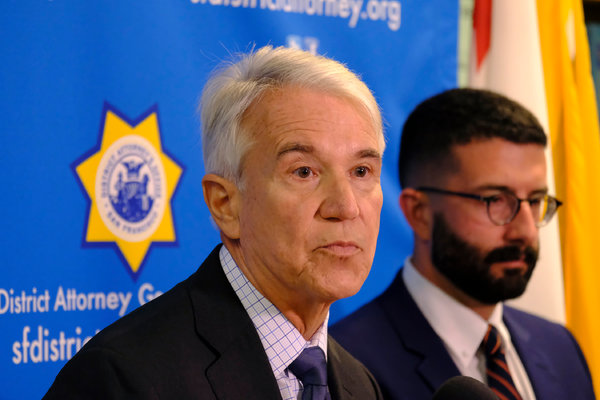 District Attorney George Gascon of San Francisco, left, was a Los Angeles police officer in the 1990s.