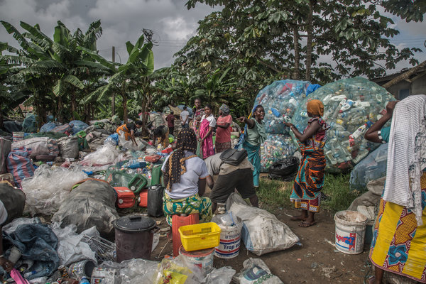 Women in an Abobo neighborhood association gather every Saturday at their collection spot to sort through and sell their plastic wares by weight.