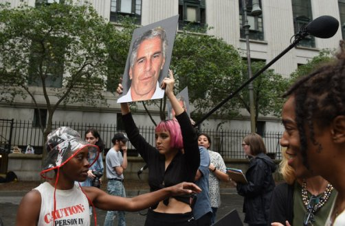 Protesters demonstrated with signs bearing the image of Jeffrey Epstein outside Federal District Court in New York on Monday.