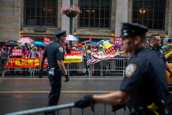 Police officers monitoring pro-China and pro-Taiwan demonstrators outside the hotel in New York where Ms. Tsai arrived on Thursday.