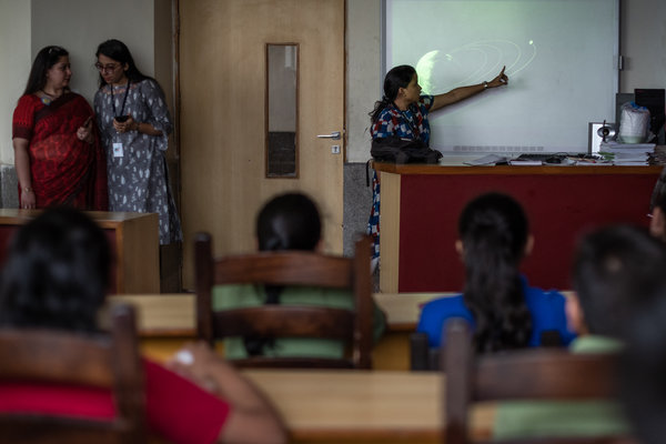 Namrata Bera, a teacher employed by the company Space India, during a lesson on the forthcoming launch of India's lunar exploration mission at a school on the outskirts of New Delhi.