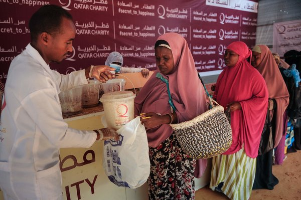 A food distribution center financed by a Qatari charity feeds displaced people in Mogadishu.