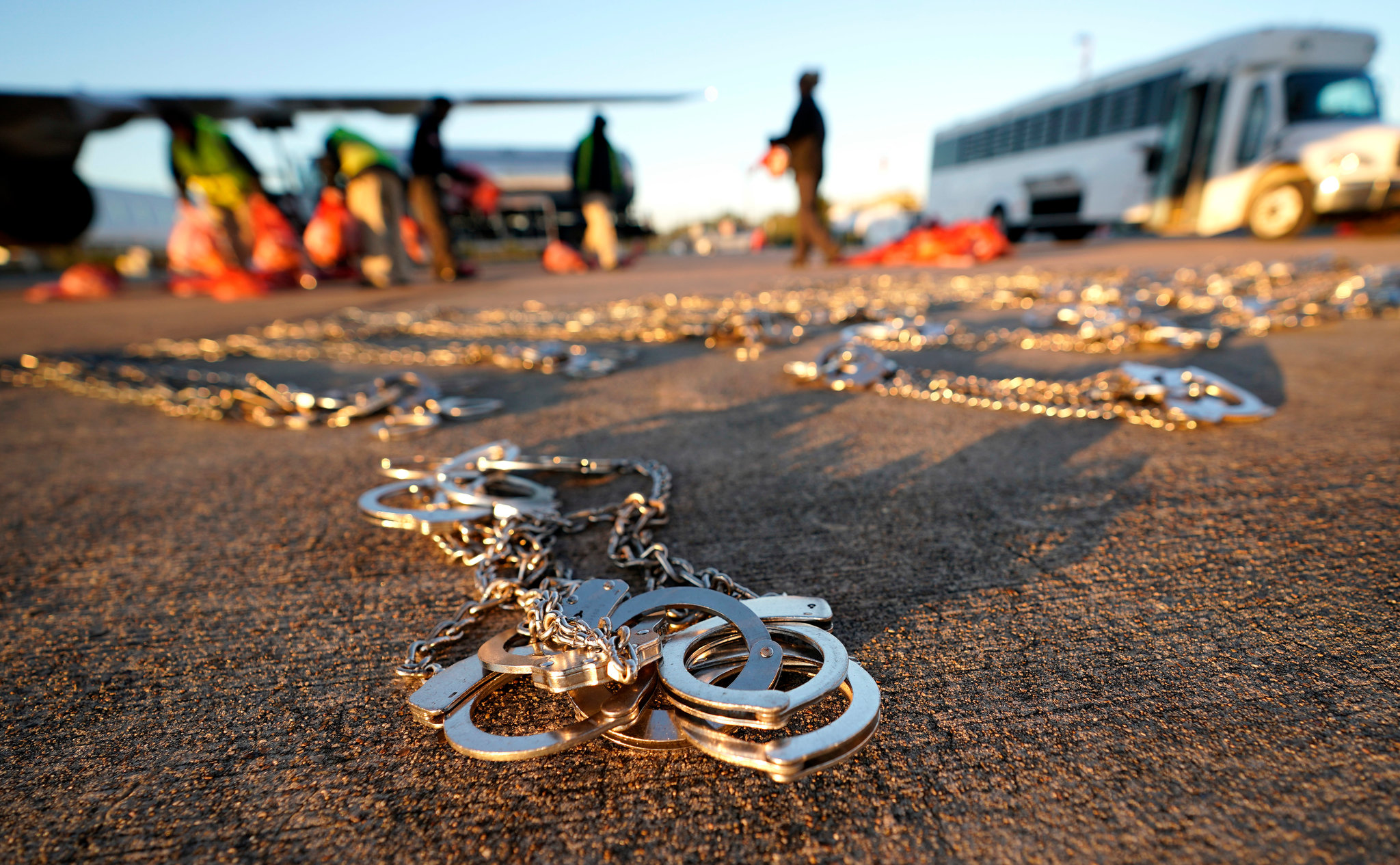 Handcuffs left on the tarmac as immigrants were loaded onto a plane for a deportation flight from Texas to El Salvador last year.