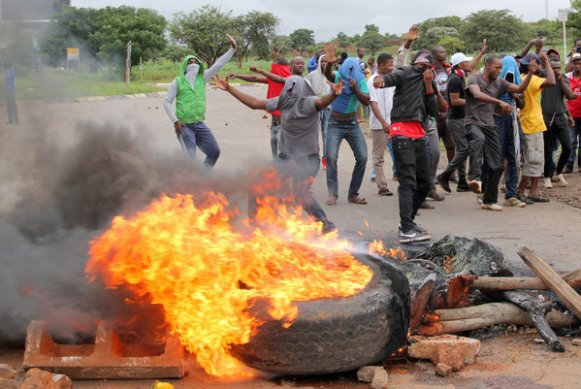A protest in January on a road leading to Harare. The military was deployed in January to dispel protests against a fuel price hike.