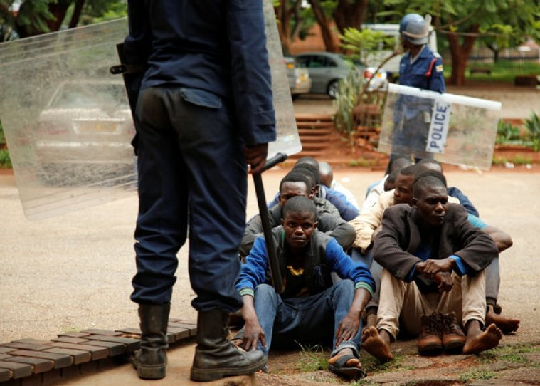 People arrested during protests waited to appear in the Magistrates court in Harare in January.