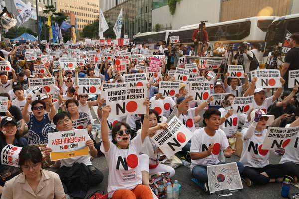 """A demonstration in Seoul on Saturday protesting Japan's decision to remove South Korea from a so-called """"white list"""" of favored export partners."""