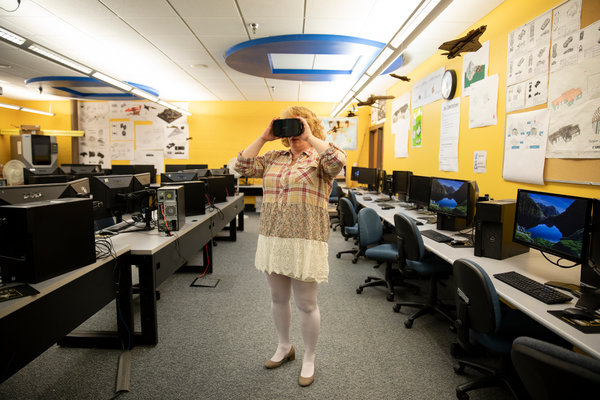 Sharon Deutscher testing one of the virtual reality headsets at Sheridan High School.