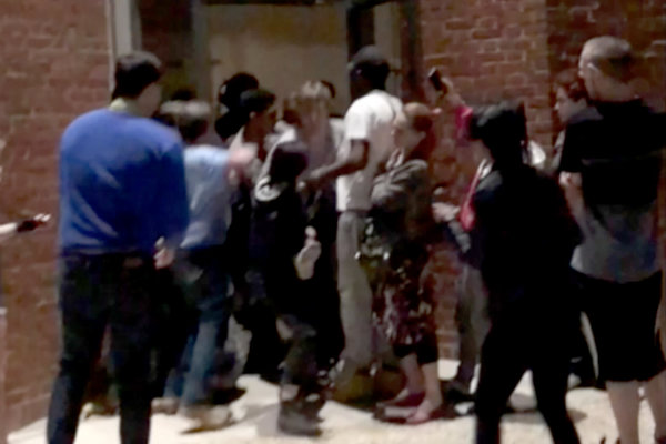 A video taken by a protester captures a scuffle breaking out as Daniel Povey, a professor, is led out of the building.