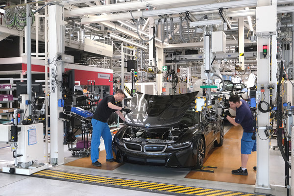 Workers at a BMW plant in Leipzig, Germany. German automakers make much of their revenue in China, where auto sales have been slipping after years of explosive growth.