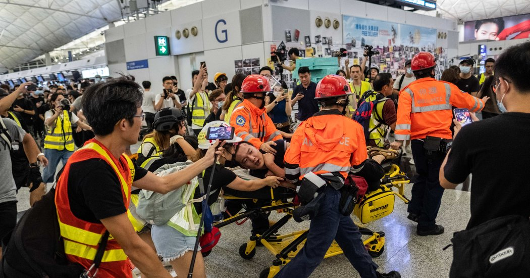 Protesters Given Prison Terms for Beating Reporter at Hong Kong Airport