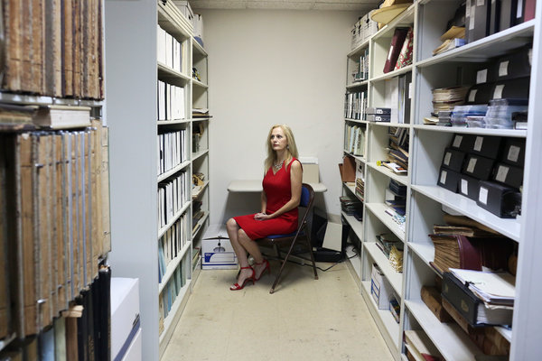 Audrey Sikes, city clerk for Lake City, Fla., in the vault where municipal records are kept. Lake City paid almost a half-million dollars after a ransomware attack