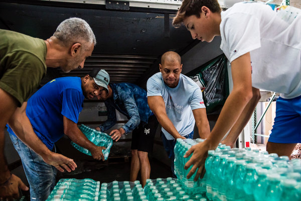 Volunteers in Miami gathered cases of water on Tuesday that are being donated to the relief effort in the Bahamas.