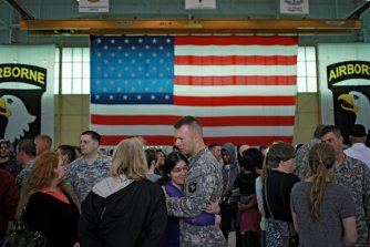Families at Fort Campbell greeted soldiers returning from a deployment in 2015. Projects at the base and around the globe have been shelved in order to fund the border wall.