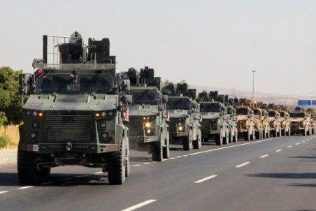 A Turkish military convoy near the Turkish-Syrian border on Wednesday.