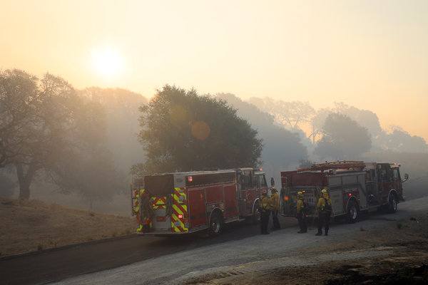 Firefighters staged in Windsor, Calif., to look for hot spots on Monday. They have been working to contain the Kincade fire since it began on Wednesday.