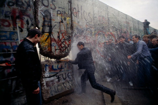 East German police sprayed water on West Germans as they broke through the wall at the Brandenburg Gate in Berlin on Nov. 11, 1989.