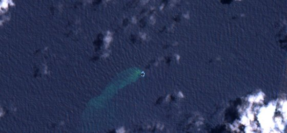 The island, seen by satellite on Oct. 10, before the eruption.