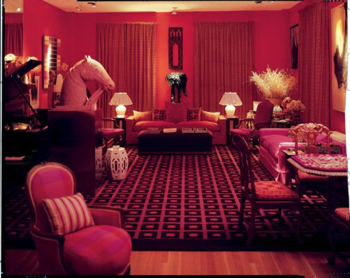 David Hicks's red-and-pink living room in South Oxfordshire, England, photographed in 1973.
