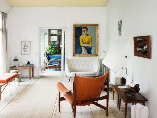 """Finn Juhl's living room in Charlottenlund, Denmark, with a Hovdingestole chair and Vilhelm Lundstrom's """"Portrait of Hanne Wilhelm Hansen"""" (1946), photographed in 2013."""