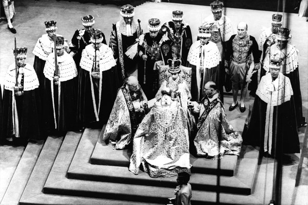 """Queen Elizabeth II's coronation on June 2, 1953. One of her first acts was to give Philip """"a place of pre-eminence and precedence next to Her Majesty."""""""