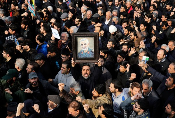 Iranians mourned the killing of General Suleimani in Tehran on Friday.