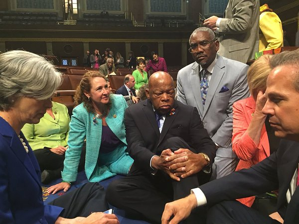 Mr. Lewis with other members of Congress staging a sit-in on the floor of the House of Representatives in June 2016, demanding that the Republican-led body vote on gun control legislation after the Orlando nightclub massacre.
