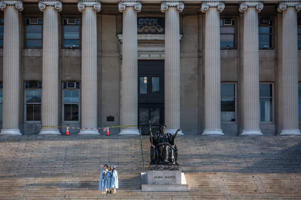 Selfies at Columbia University on Wednesday. New C.D.C. numbers indicate that young adults are not immune from infection.