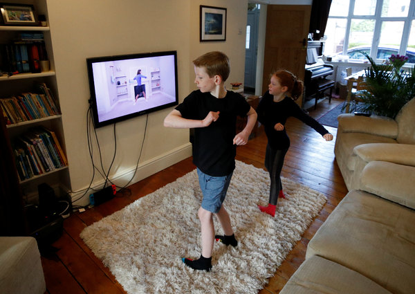 Children in Manchester, England, taking part in an exercise class via YouTube.