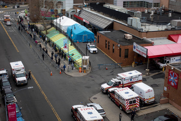 Outside the Elmhurst hospital in Queens, N.Y., on Wednesday. People arrive as early as 6 a.m. to be tested for the coronavirus.