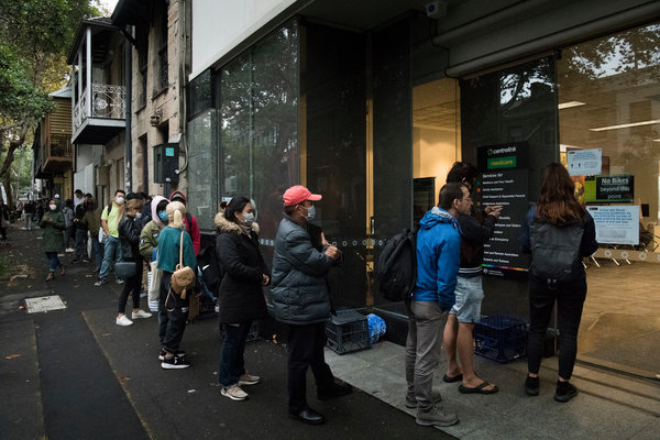 A line outside Centrelink, which manages government aid, in Sydney in March.