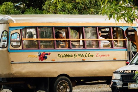 Riders on a bus in Fagatogo. Capacity on buses was limited to promote social distancing.