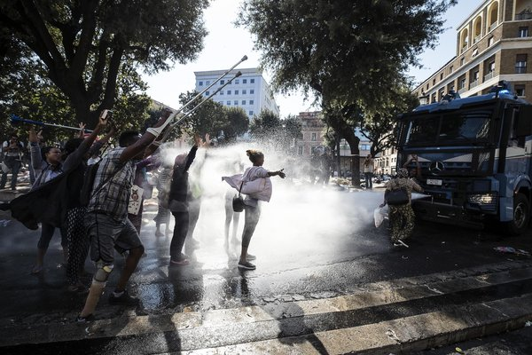 The Italian police used water cannons to disperse Eritrean and Ethiopian migrants from buildings they occupied in Rome in 2017.