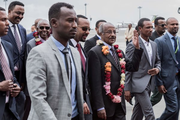 The Eritrean foreign minister, Osman Saleh Mohammed, center right, and the Ethiopian prime minister, Abiy Ahmed, center left, in Addis Ababa in 2018.