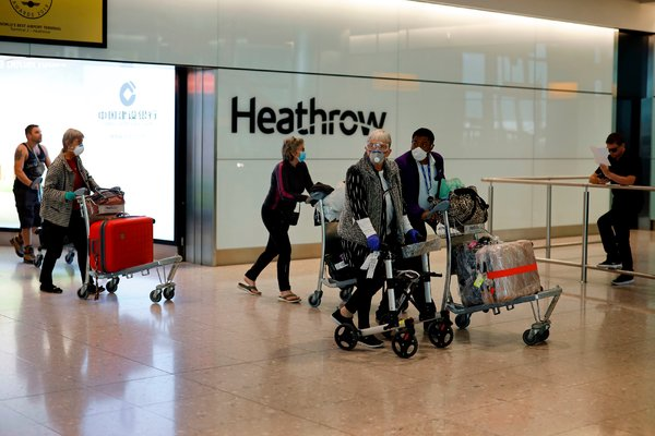 Passengers arriving at  Heathrow Airport on Friday.