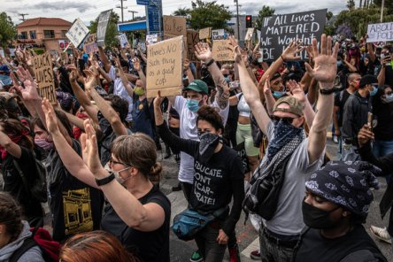 "Protesters raised their hands, chanting ""hands up, don't shoot!"" during a demonstration against police brutality in Los Angeles last month."