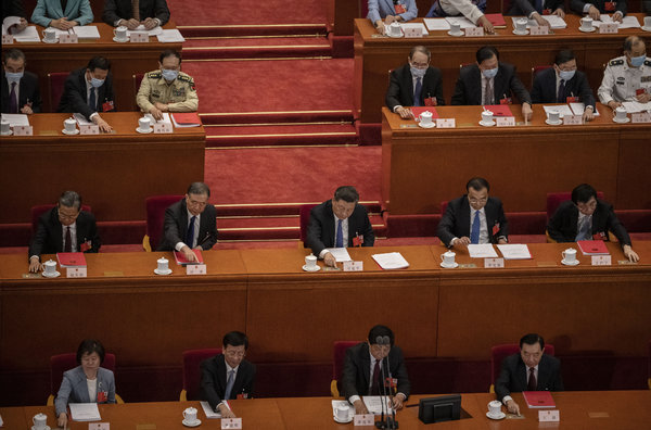 China's leader, Xi Jinping, center, at the National People's Congress in Beijing last month.