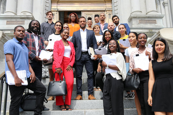 Mr. Holness, center, with members of Montreal in Action submitting the 22,000 signatures that in 2018 legally required the city to hold hearings into systemic racism and discrimination.