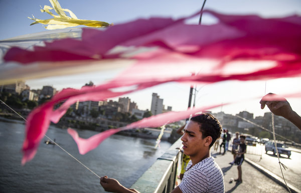 Flying kites on a bridge over the Nile last month.