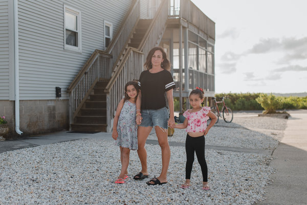 """Emily James, a high school English teacher in Brooklyn, with her two daughters. Ms. James said that balancing work and child care in the fall would feel like """"a puzzle that doesn't match."""""""
