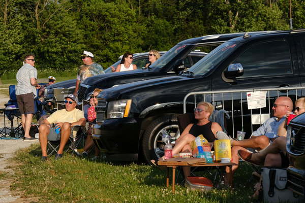 Fans at a drive-in Yacht Rock Revue concert enjoyed the show from a distance.