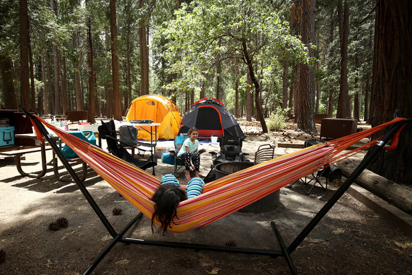 Noah and Valentina Gonzalez relaxed at their campsite in Yosemite National Park in June.