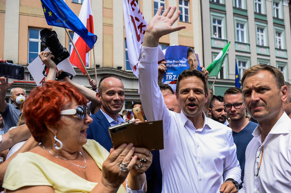 """Rafal Trzaskowski at a campaign rally on Friday. """"Have you ever heard such homophobia, such anti-Semitism, such attacks on everybody who is brave enough to say 'We have had enough'?"""" Mr. Trzaskowski asked his supporters."""