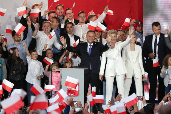 President Andrzej Duda and his supporters cheer as exit poll results are announced in Pultusk, Poland on Sunday.