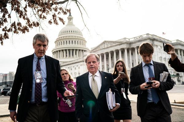 Senator Doug Jones talking to reporters on Capitol Hill in February.