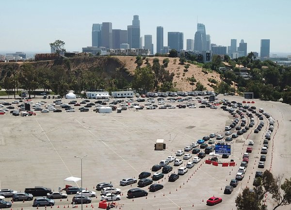 A long line of cars at a coronavirus testing site at Dodger Stadium in Los Angeles on Wednesday.