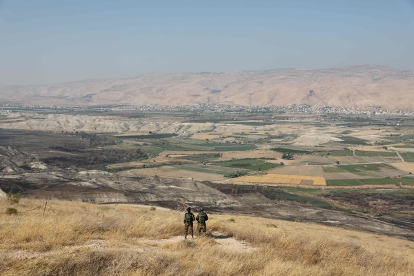 Israeli soldiers overlooking the Jordan Valley on the occupied West Bank. Prime Minister Benjamin Netanyahu of Israel has said he intends to annex the area.