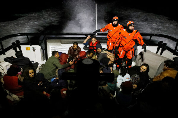 Migrants on board a Turkish coast guard boat following a failed attempt to cross to the Greek island of Lesbos in March.